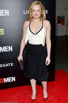 Monochrome madness: Elisabeth Moss donned a low-cut black and white number...