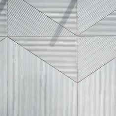 EQUITONE's facade panel [linea] is a unique 3D shaped, through-coloured facade material that plays with light and shadow. Linea displays a linear texture that highlights the raw inner texture of the core fibre cement material. Every moment of the day, the changing angle of the daylight gives the facade material a different aspect. The material comes in a large panel size and can be transformed into any size or shape in the workshop or on site.