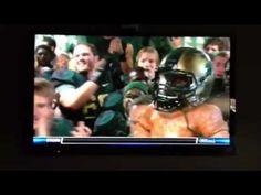 MSU football team singing fight song in locker room after game against U of M, with Paul Bunyan trophy (wearing State helmet) and Coach Dantonio