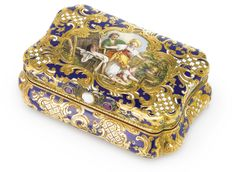 A GERMAN GOLD AND ENAMEL SNUFF BOX WITH SIGNED ENAMEL, CHARLES COLINS SONS, HANAU, CIRCA 1840-50 of bombé cartouche shape, the cover enameled en plein with a youth and blind-folded girl surrounded by putti, the surface engraved with rococo ornament on white and blue enamel grounds, the thumbpiece set with an opal flanked by two rubies marked inside base and cover, the enamel signed B. px.