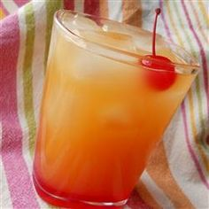 Pineapple Upside-Down Cake-   splash grenadine syrup, 1.5 fluid ounce cake-flavored vodka, 3 ounces pineapple juice- Pour over crushed ice. Garnish with maraschino cherry.