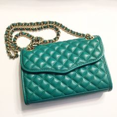 Rebecca Minkoff Mini Affair Excellent used condition. Only carried a couple times. The color is very true to pictures. It is a beautiful green color. Has gold hardware. Has dust bag. 100% Authentic. Shows very little signs of wear. I would rate this bag a 9 out of 10. I don't trade so please do not ask. I only sell on Posh so don't ask if I sell on other sites or take paypal.  Do not ask what my lowest is or comment with an offer price. Rebecca Minkoff Bags Crossbody Bags