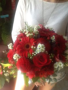 Fresh red roses, red gerberas, red dahlias, red alstroemerias, white spray asters, red safari sunset bridal bouquet by Mari Lynne, Floral Expressions, Beaver Dam, WI