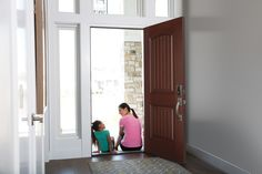 Enjoy time together as mother and daughter at a home entryway featuring a Belleville series Mahogany textured fiberglass entry door. Exterior Doors, Interior And Exterior, Fiberglass Entry Doors, Glass Door, Tall Cabinet Storage, Entryway, Daughter, Wood, Furniture