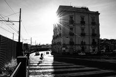Luce e Ombra.  18mm * 1/400 * f/9 * ISO-200  #catania #sicily #italy #blackandwhite #sun #sunray #sunbeam #luce #ombra #light #shadow #contrast #street #streetphotography #lines #stripes #bicycle #cars #digital #nikon