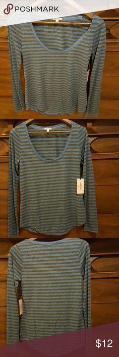 WILL BE REMOVED MIDNIGHT TODAY***** Will be removed 3/1 to make room for new items.  Very sexy fitted blue striped long sleeve shirt, size small.  Brand new shirt with tags still attached.  I don't sell anything that I wouldn't want to get.  Love the shirt but its too tight in the chest area, received as a gift.  All items come from a smoke free and pet free home. Juicy Couture Tops Tees - Short Sleeve
