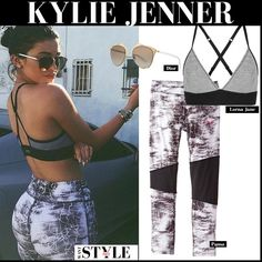 Kylie Jenner in grey sports bra, grey marble print leggings and mirrored Dior sunglasses
