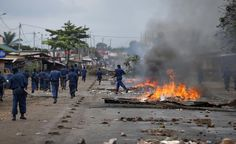 Policemen walk next to barricades during a protest against Burundi's President Pierre Nkurunziza and his bid for a third term in Bujumbura, Burundi, May 22, 2015. REUTERS/Goran Tomasevic