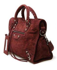 BALENCIAGA   'Classic city' burgundy suede bag. This would be super cute with jeans and a white tee.