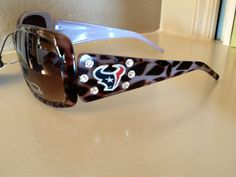 the Die Hard Texans Fan These gorgeous sunglasses are perfect for the ultimate Texans fan! They are custom adorned with genuine Swarovski elements and the Houston Texans logo. Best Cover Up Tattoos, Bulls On Parade, Houston Texans Football, Jj Watt, Sports Fanatics, San Francisco 49ers, Rockets, Fandom, Bling