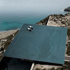 Mirage house by Kois Associated Architects with rooftop infinity pool