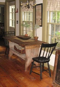 Primitive...table & chairs.