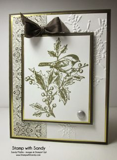 handmade card from Stamp With Sandy ... gold embossed line are image of bird perched on holly branches ... shiny gold mats ... delightful!