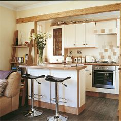 Open Style Galley Kitchen - Edges outlined in wood.