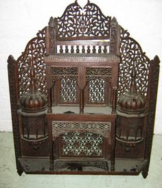 WALL SHELVES, Moorish architectural design, carved and pierced wood, 60.5cm x 78cm H.