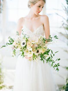 Anemone and greenery wedding bouquet: http://www.stylemepretty.com/2017/05/09/inspiration-for-a-modern-loft-meets-garden-wedding/ Photography: Natalie Bray - http://nataliebray.com/