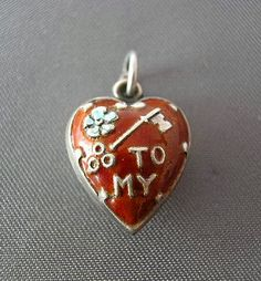 "VINTAGE ENAMEL ""KEY TO MY HEART"" STERLING PUFFY CHARM"