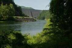 When completed in 1944 for the war effort, the 480-foot high Fontana Dam became the highest in  the Eastern United States and the fourth highest in the nation. Below the dam, the Little Tennessee River continues through the Cheoah, Calderwood and Chilhowee reservoirs before joining the Tennessee River in Lenoir City, Tennessee. Near Bryson City, NC.