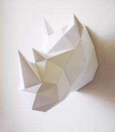 A Rhino folding kit to create a big paper wall trophy. The assembled size of the rhino is 39x27x40 cm. It looks really great and modern on your wall. The kit contains 3 large posters, glue, a folding lath and includes all the information needed to assemble this rhino yourself! http://cargocollective.com/assembli/Animal-friendly-rhino-DIY-kit