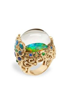 Temple St. Clair ~ Medusa Moon Jellyfish ring featuring a rare, luminous Australian Andamooka opal, Lightning Ridge black opals, sapphires, tsavorites, hauyne and rock crystal.