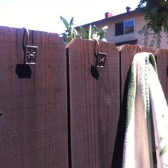 Shower curtain hooks for outdoor towel holder. (inexpensive at stores like Ross or TJMaxx)