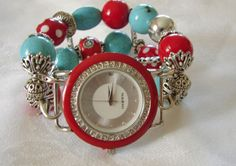 Check out this fun red, white and turquoise chunky beaded watch band. Its is fun, bright and crisp with its silver accents. Don't forget the whimsical red and white polka dot bead for added detail. It is paired with a large round red and silver Narmi watch face.