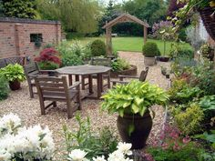 Brick Garden Fence Wall Design with Wooden Table Chairs