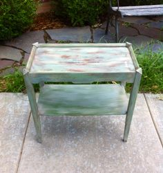 Garage sale table makeover. Dry brushed antique white and duck egg blue. Used transfer paper and a sharpie to trace French typography from The Graphics Fairy.  After distressing I used walnut stain as a glaze. Finished with wipe on poly. #thegraphicsfairytransfer #drybrusheddistressedtable #usingstainasaglaze