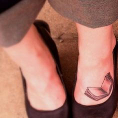 Book on the foot tattoo. With ALWAYS written with the deathly hallow symbol...