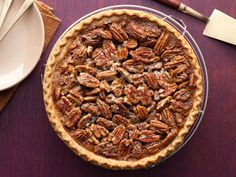 Chocolate Pecan Pie recipe from Paula Deen via Food Network or see Trisha Yearwood's version.  Pecans lined neatly.