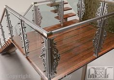 Glass and stainless steel railing. Nice mix of modern and traditional.