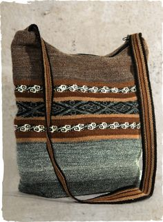 The manta-striped earth tone wool bag is handwoven by Quechua artisans in the highlands of Peru.