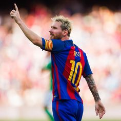 Lionel Messi of FC Barcelona celebrates after scoring his team's second goal during the La Liga match between FC Barcelona and Real Betis Balompie at Camp Nou on August 20, 2016 in Barcelona, Catalonia.
