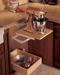 storage for kitchen aid. My mom has this and I cannot imagine life without it! LOVE!!