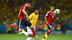 2014 FIFA World Cup™ - Photos - FIFA.com  James Rodriguez of Colombia controls the ball as Paulinho of Brazil gives chase