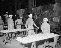Members of the Women's Army Auxiliary Corps at work in a British Army bakery at Dieppe, France, on 10 February 1918. Photographer: Second Lieutenant David McLellan. IWM Q 8475.