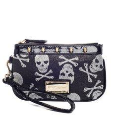 I love the Betsey Johnson Sparkle Skulls Wristlet from LittleBlackBag