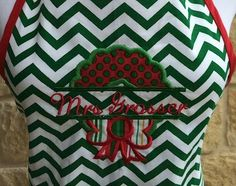 "Our custom made Christmas apron is available in three fun fabrics with four festive appliques. Great for your favorite cook. Please use our coupon code ""holiday15"" for 15% off your holiday gift purchase"