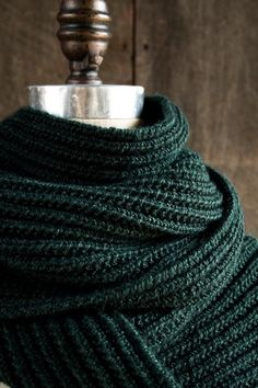 Lightning Fast Mistake Rib Scarf Knitting Needle Size: 6 or 4 mm Yarn Weight: (3) Light/DK (21-24 stitches to 4 inches) Measurements: (with rib unstretched): 7 inches x 70 Inches Materials:     Black Green Purl Soho's Mulberry Merino - 4 skeins     A US #6 circular or straight needl