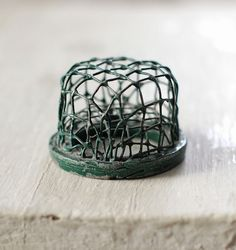 Small cage style flower frog - green