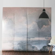 A clouded mural and wallpaper