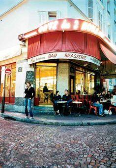 The entrance to the cafe [Cafe des Deux Moulins].