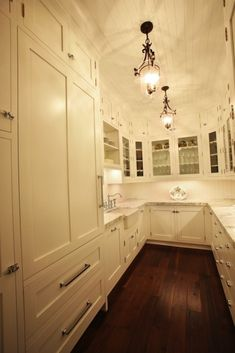 kitchens - beadboard ceiling farmhouse sink polished nickel hinges hardware marble countertops white glass-front shaker kitchen cabinets  Fantastic