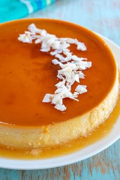 The easiest Coconut Flan with a microwave caramel sauce! Flan de Coco is beloved in Puerto Rico, Cuba, Mexico - one creamy bite and you'll see why! Coconut Flan, Coconut Pudding, Coconut Recipes, Puerto Rican Flan, Puerto Rican Recipes, Carne Guisada Recipe Mexican, Pyrex, Chocolate Tres Leches Cake, Recipes