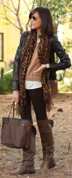 Awesome style!  Riding style leggings, leopard print scarf, mini black leather jacket, tall brown boots. Obsessed with this look
