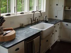 Traditional Style Kitchens with Ranch Style Apron Sinks, Black Soapstone Kitchen Countertops, and White Finish Recessed Cabinet Panels - Farm Style Sink