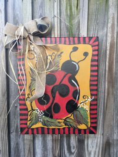 A personal favorite from my Etsy shop https://www.etsy.com/listing/529602309/door-hanging-ladybug-16-x-20