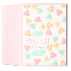 Pastel candy hearts with sweet messages decorate this Valentine's Day card from Marcel Schurman.