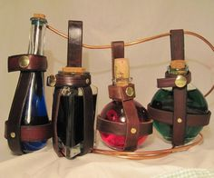 Every brave adventurer needs to carry around liquids and components with him. What better way than in a glass potion bottle with a handmade leather holder?I've made several dozen of these, and if you're interested I've documented the step by step process.