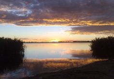Photo about This lovely picture was taken one late afternoon at a remote fishing spot in the Lakeview area of Welkom, (a small town in South Africa). Image of peaceful, still, lake - 39246403 Sunset Images, Free State, Lake View, Small Towns, South Africa, Clouds, Stock Photos, Explore, Places